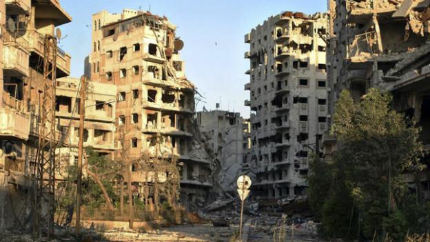 Ausgebombtes Wohnquartier in Homs (Foto vom Sommer 2013).