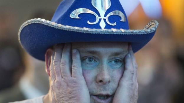 Ein Anhänger des «Parti Québécois» zeigt sich enttäuscht über das Wahlresultat.