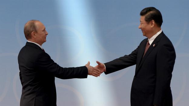 Russlands Präsident besucht China: Vladimir Putin (links) und Xi Jinping (rechts).