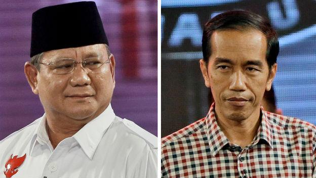 Die Fotos der beiden Kandidaten: links Prabobo Subianto in weissem Hemd und schwarzem Hut, rechts Joko Widodo in einem bunt-karierten Hemd