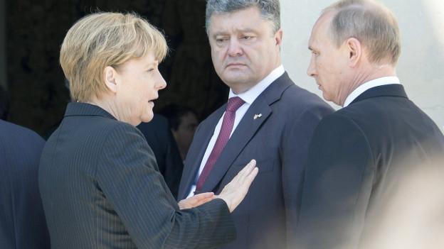Deutsche Kanzlerin, ukrainischer Präsident Poroschenko sowie Russlands Staatschef Putin.