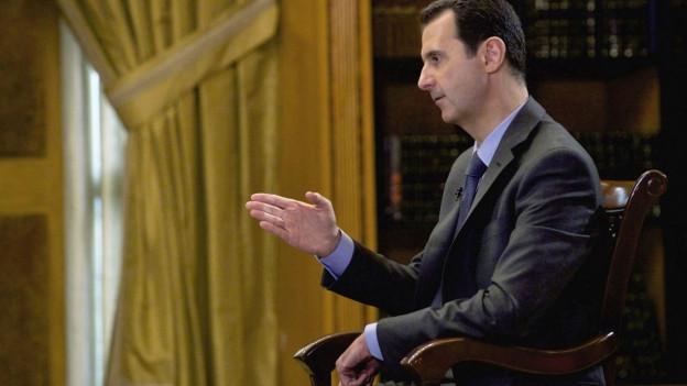 Auf dem Bild zu sehen ist Syriens Machthaber Assad während eines Fernsehinterviewsin Damaskus im September 2015