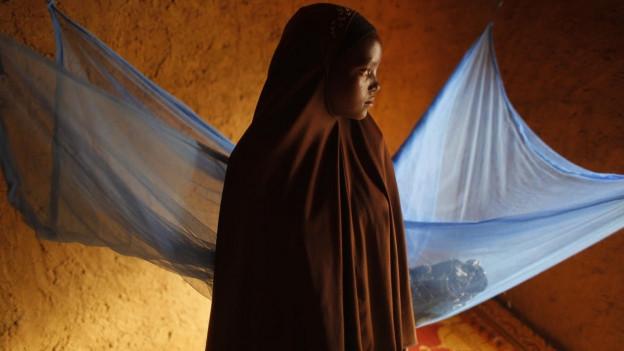 Auf dem Bild zu sehen ist ein ein 12-jähriges Mädchen, das kürzlich verheiratet wurde