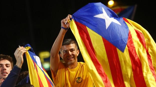 Anhänger einer katalanischen Unabhängigkeit feiern.