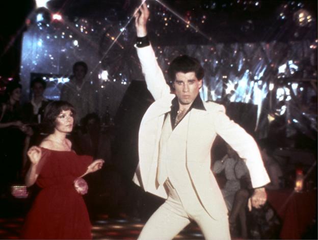 """Das Bild zeigt John Travolta und Karen Lynn Gorney in einer Szene aus """"Saturday Night Fever""""."""