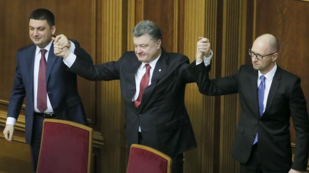 Parlamentspräsident Wladimir Groisman, Präsident Petro Poroschenko und der bisherige Ministerpräsident Arsenij Jazenjuk.