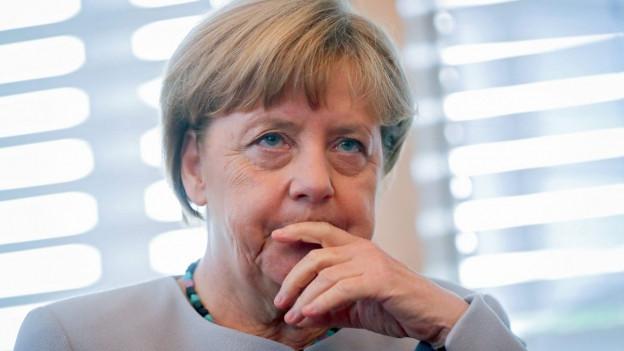 Das Bild zeigt ein Porträt von Merkel