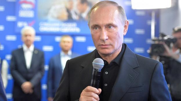 Wladimir Putin im Wahlquartier seiner Partei: Er kann zufrieden sein mit dem Ausgang der Wahlen.