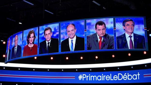 Auf einer Leinwand erscheinen die sieben bürgerlichen Kandidaten vor dem TV-Duell in Frankreich (13. Oktober 2016).