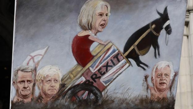 Premierministerin Theresa May auf einer satirischen Zeichnung.