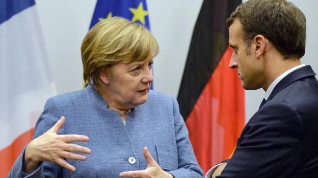 Die deutsche Bundeskanzlerin Angela Merkel mit dem französischen Präsidenten Emmanuel Macron.