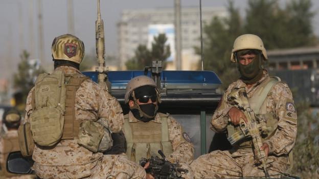 "Drei Mitglieder der ""Afghan Security Forces"" in Kabul."
