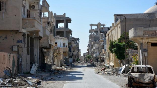 Blick in eine zerstörte Strasse in Syrien.
