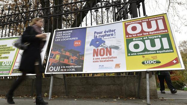 Abstimmungsplakate in der Stadt Genf.