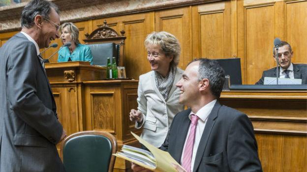 Bundesrätin Eveline Widmer-Schlumpf, Philipp Mueller, FDP und Christophe Darbellay, CVP bei der FATCA Debatte im Nationalrat.