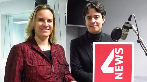 Zu sehen sind die Berner SVP-Nationalrätin Andrea Geissbühler und der Waadtländer SP-Nationalrat Jean-Christophe Schwaab.