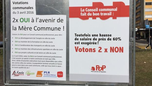 Abstimmungsplakate in Le Locle die für, resp. gegen die Abstimmungsvorlage werben.