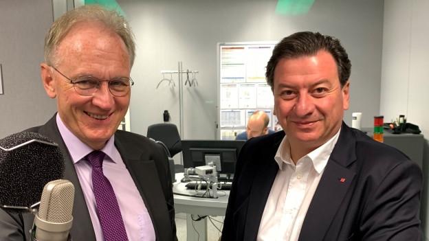 Auf dem Bild sind die beiden Nationalräte Hans-Ulrich Bigler (links) und Corrado Pardini (rechts) zu sehen.