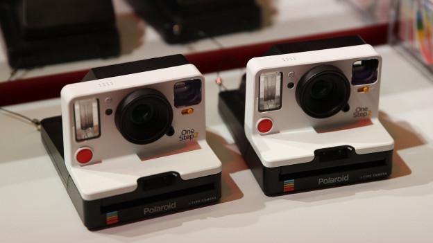 Abdrücken, Foto schütteln, anschauen: Polaroid-Kameras
