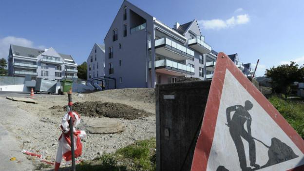 Bauboom in der Schweiz: Nicht alle Bauherren haben genügend Geld, Banken sollen bei der Kreditvergabe also vorsichtiger sein.