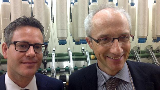 Textilverbands-Direktor Peter Flückiger und Martin Kägi, Chef der Hermann Bühler AG.