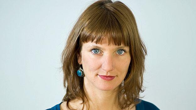 Portrait von Andrea Hüsser.