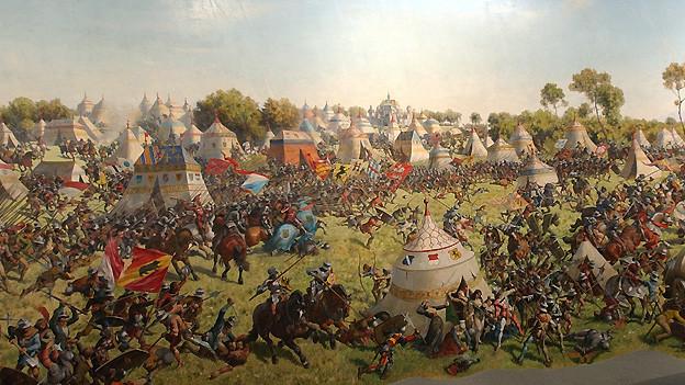 Das Panoramabild zur «Schlacht von Murten» wurde 1893/94 von Louis Braun gemalt. Es zeigt die erdrückende Übermacht der burgundischen Heere Karls des Kühnen von 1476. Das Panoramabild wurde im Rahmen der Expo.03 im Innern des Monolithen in Murten ausgestellt.