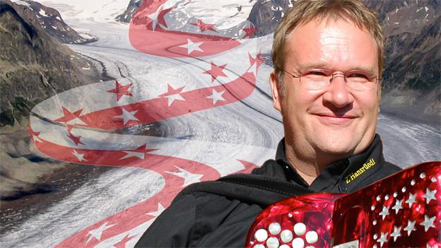 Hansrüedi mit Akkordeon vor Bergkulisse und Walliser Flagge die sich als Grafik durch die Schlucht zieht.