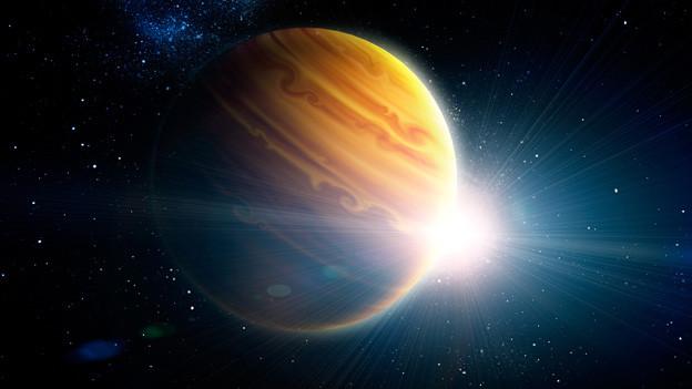 Grossaufnahme des von hinten beleuchteten Planeten Jupiter.