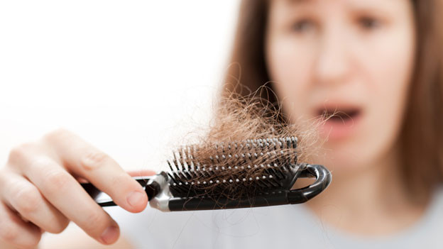 Verfilzte Haarbürste