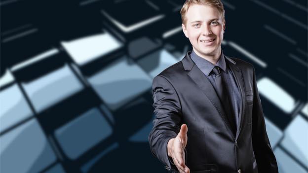 Jung Banker-Typ im grauen Anzug streckt Hand zur Begrüssung hin.