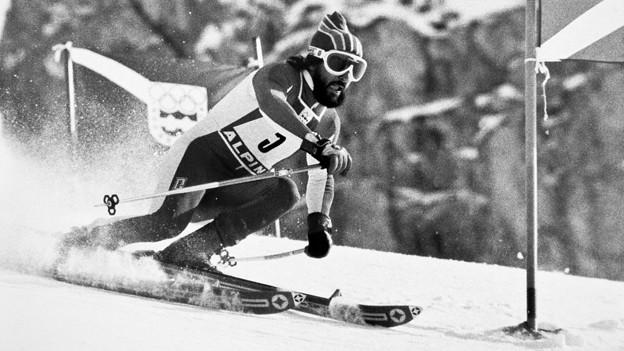 Der Schweizer Riesenslalom-Olympiasieger Heini Hemmi während seiner Siegesfahrt an den Olympischen Winterspielen 1976 in Innsbruck am 10. Februar 1976.