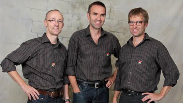 Gruppenfoto mit den drei Musikanten.