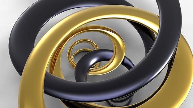 Zwei verschiedenfarbige Metallstränge in einer Spirale.