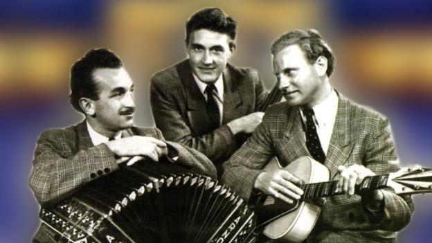 Die drei Travellers mit Gitarre.