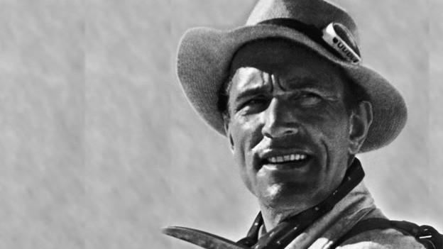 Die Schwarz-Weiss Fotografie zeigt den Bergsteiger Luis Trenker in jungen Jahren.