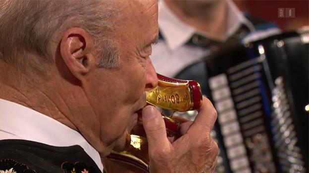Ein Mundharmonika-Spieler.