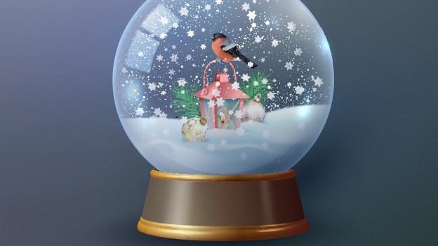 Eine Schneekugel mit einem Vögelchen darin.