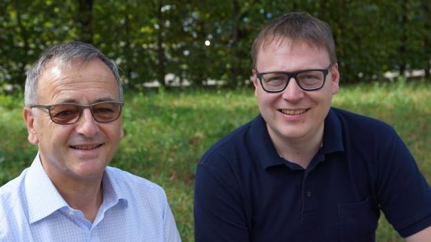 Porträt von Walter Mittelholzer und Sämi Studer.