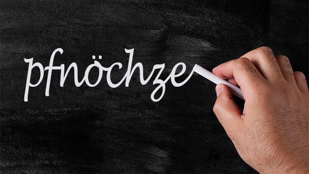 Schreibtafel mit dem Wort «pfnöchze».