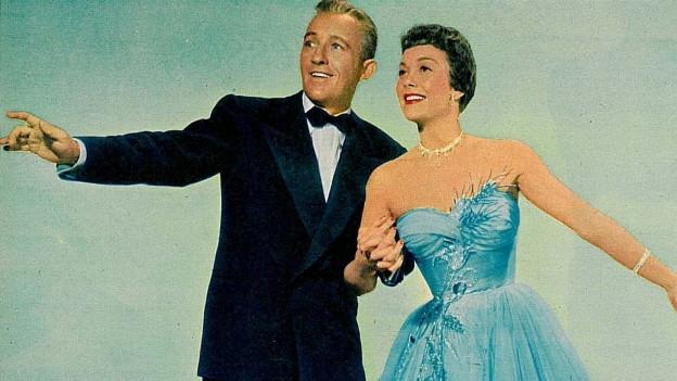 Mann und Frau auf Filmposter in galanter Abendgarderobe.