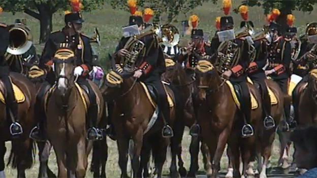 Reiter in Uniformen.