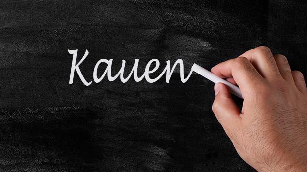 Tafel mit dem Wort Kauen.