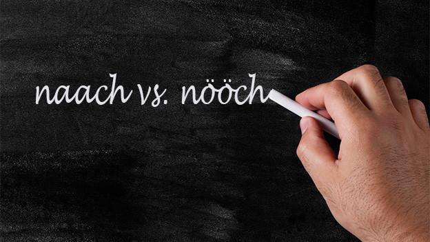 Schreibtafel mit den Wörtern naach vs. nööch.